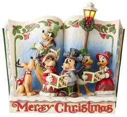 Soška s motivem knihy s vánočními koledami