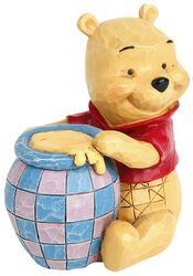 Medvídek Pu se sklenicí medu